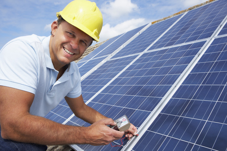 man_on_solar_panel